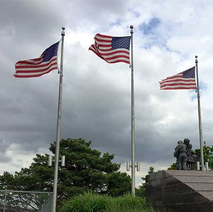 Three American flags at Memorial Park in Omaha