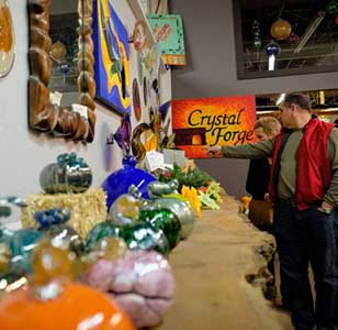 A man looks at glass art being displayed at Hot Shops in Omaha, Nebraska