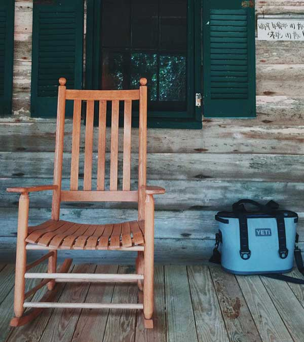 The porch at Liberty Lodge is set up for relaxation. Take a seat and admire the view