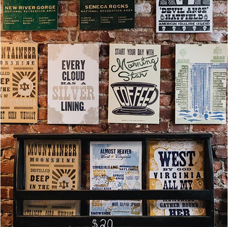 Base Camp Printing Company posters on display at their shop in Charleston, West Virginia