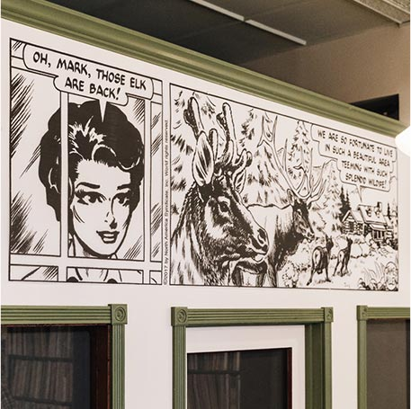 Comic strip mural decor inside Elk City Records in Charleston, West Virginia