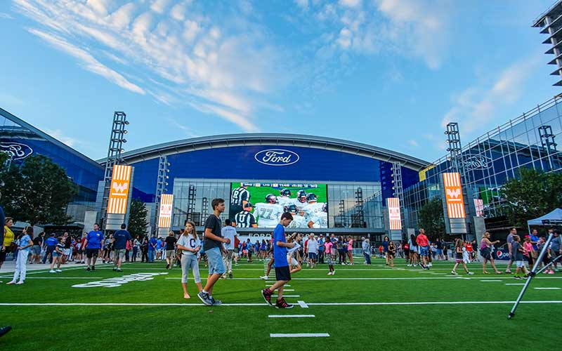 Fans visit the Ford Center field at the Star in Frisco, Texas