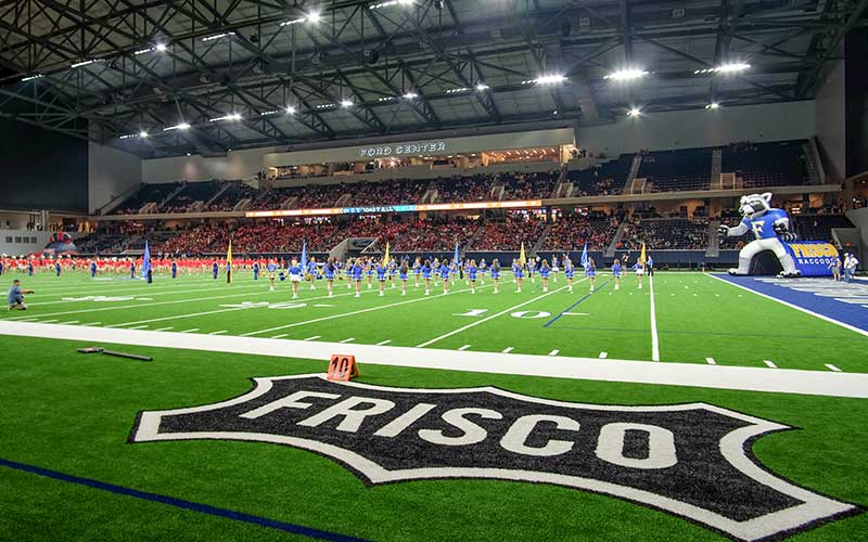 Cheerleaders on the field at the Ford Center at the Star in Frisco, Texas