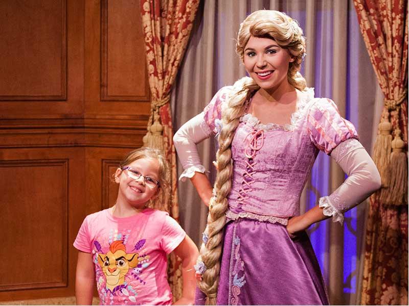 A young girl with Disney Princess, Rapunzel
