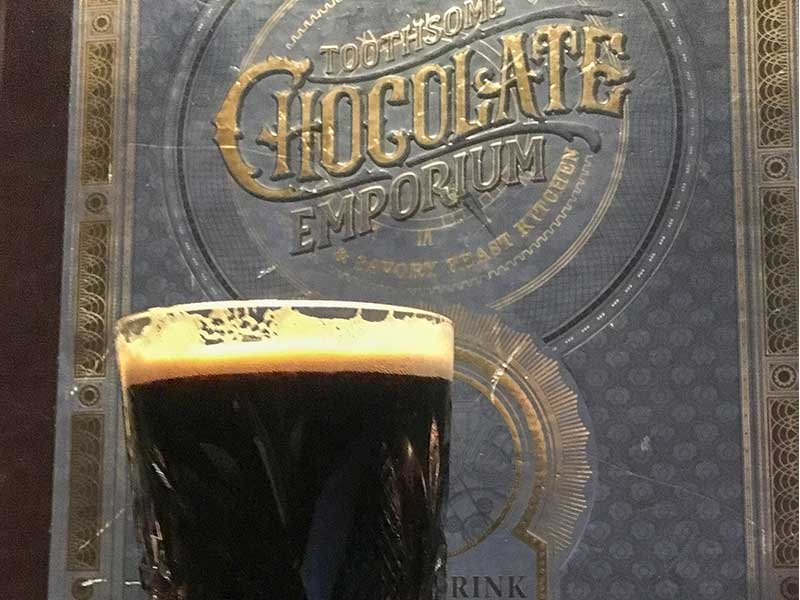 The Too Chocolate Stout and a menu at Universal's Toothsome Chocolate Emporium & Savory Feast Kitchen near Kissimmee, Florida
