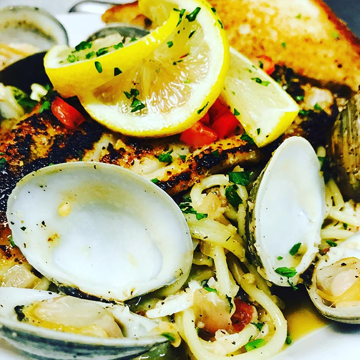 Seafood dish featuring oysters over pasta from Page's Okra Grill in Mt. Pleasant, SC