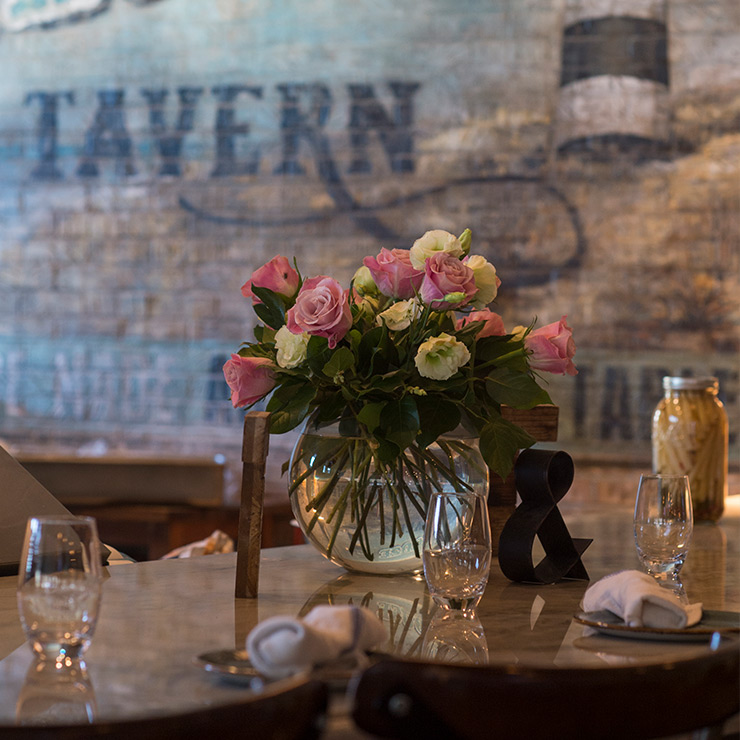 Table set and decorated with roses at Tavern & Table in Mt. Pleasant, SC