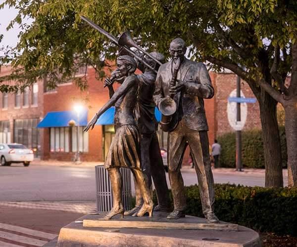 The bronze Jazz Trio sculpture by artist Littleton Alston at Dreamland Plaza on North 24th Street in Omaha, Nebraska