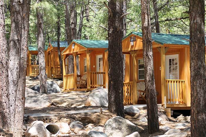 Attractive Cabins With Patios Behind Large Trees In Hualapai Mountain Park In Kingman,  Arizona