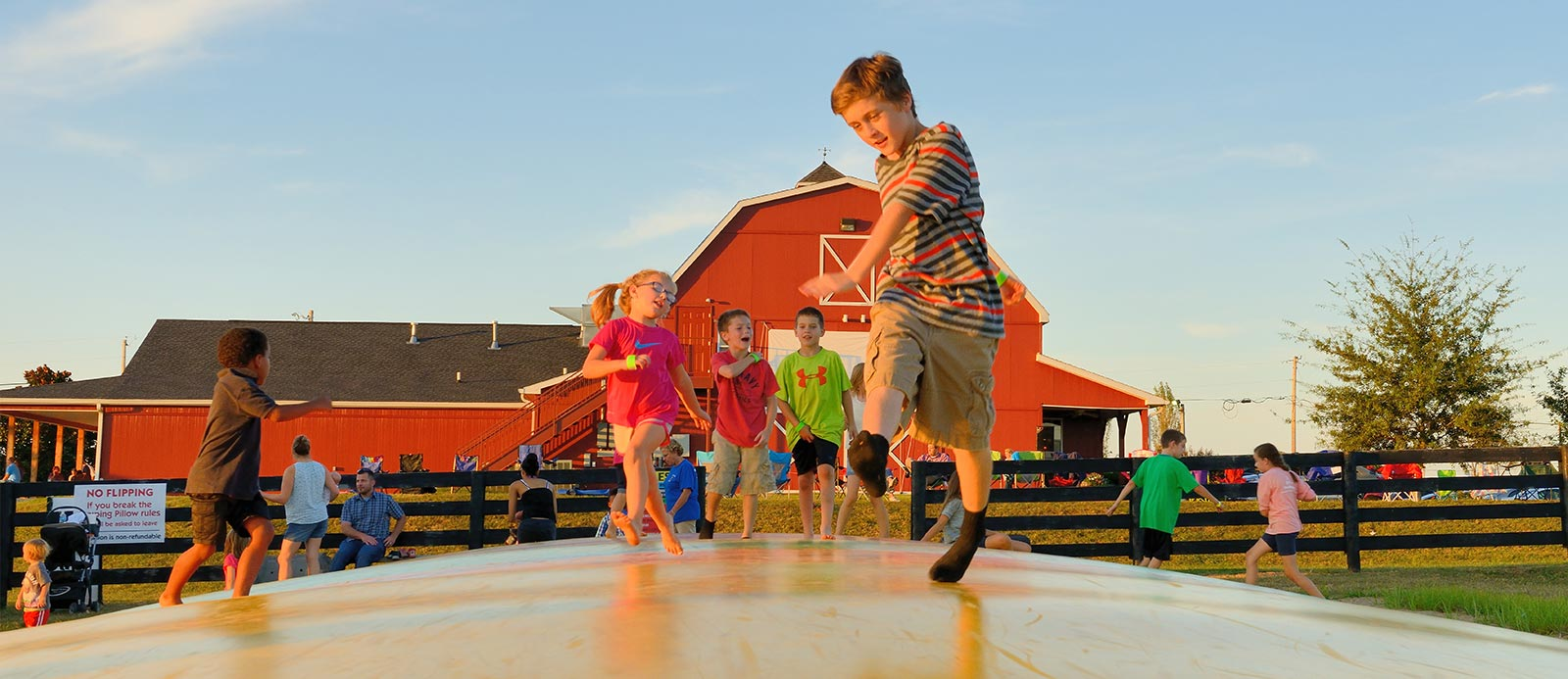 Kids jumping on an inflatable at Chaney's Dairy Barn in Bowling Green, KY