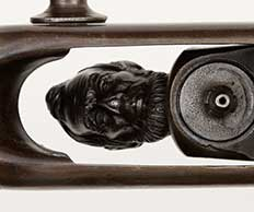 A closeup photo of the hammer of the Lincoln-Head Hammer Gun, a percussion rifle developed by Hiram Berdan as a thank you to President Abraham Lincoln, on display at the Cody Firearms Museum in the Buffalo Bill Center of the West in Cody, Wyoming
