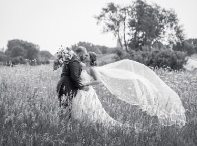 Couple kiss in a field