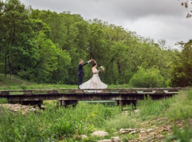 Married couple dances on a bridge