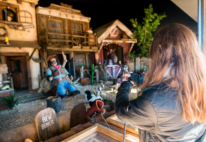Jenna Kvidt shooting at the Hualapai Ranch Shootin' Gallery at Grand Canyon West.