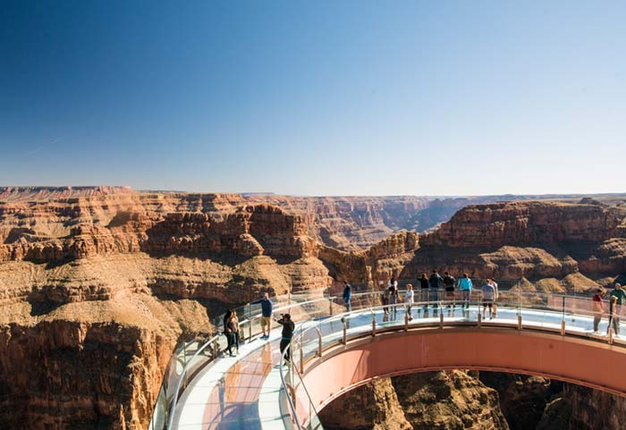 Tourists on Skywalk at Eagle Point, a glass bridge over the west rim of the Grand Canyon.