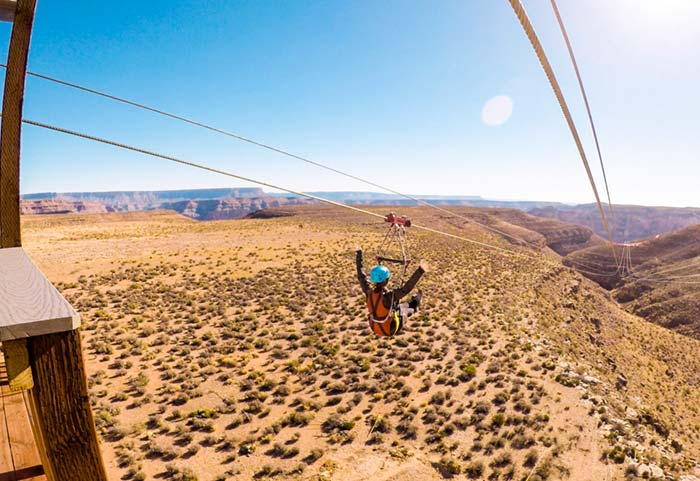 A woman riding the Grand Canyon Zipline.