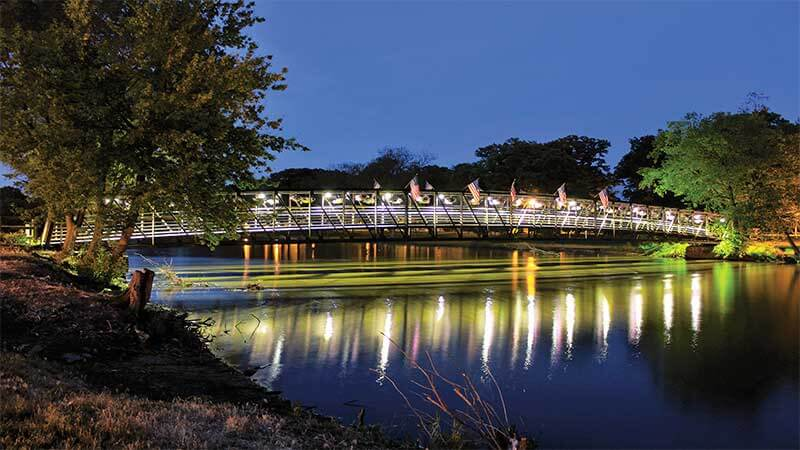 Lighted view of Momence Island Park Walk Bridge in Kankakee County, Illinois