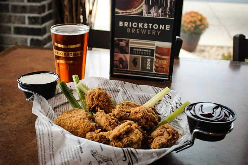 A chicken meal with a glass of beer at Brickstone Brewery in Kankakee, County Illinois