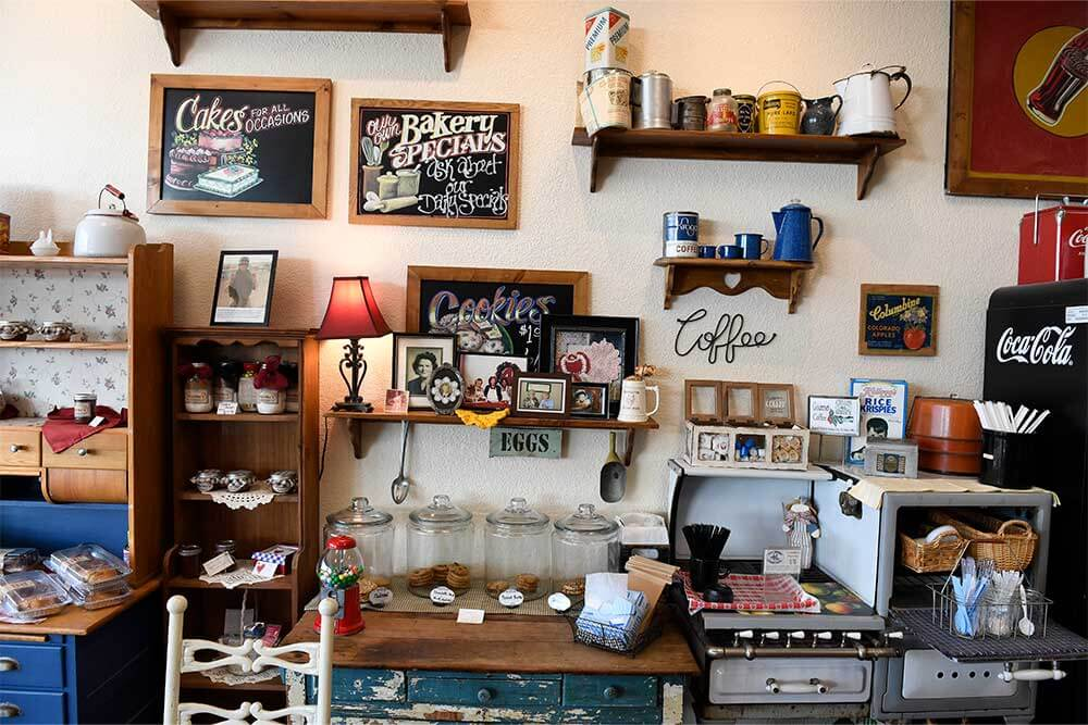 Down-home and country-style knick-knacks, souvenirs and baked goods line a wall at MeMa's Old-Fashioned Bakery in Kansas City, KS