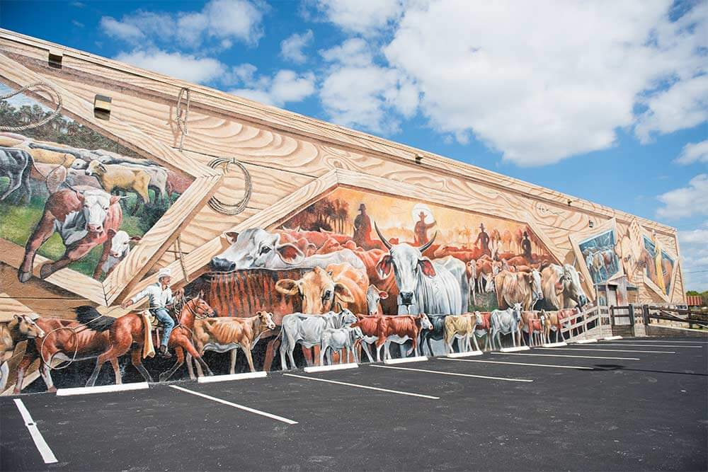 One of the murals of Lake Placid, Florida, depicting cattle and cowboys, painted on the side of a building