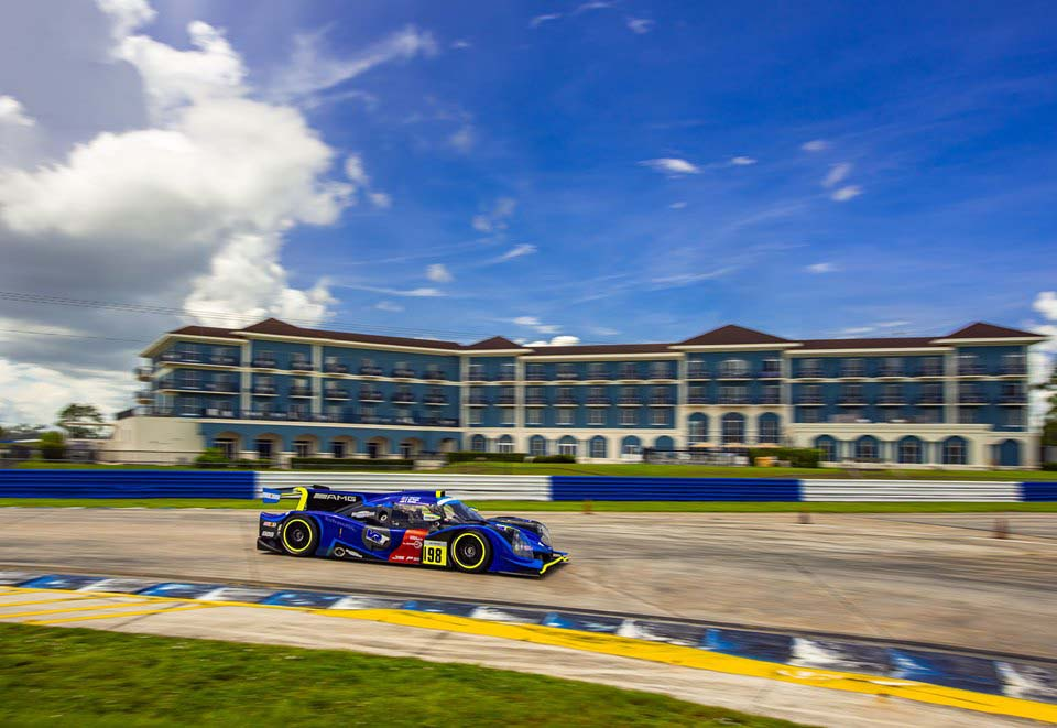 The Chateau Elan Hotel & Conference Center overlooks the racetrack and race cars at the Sebring International Raceway in Sebring, Florida