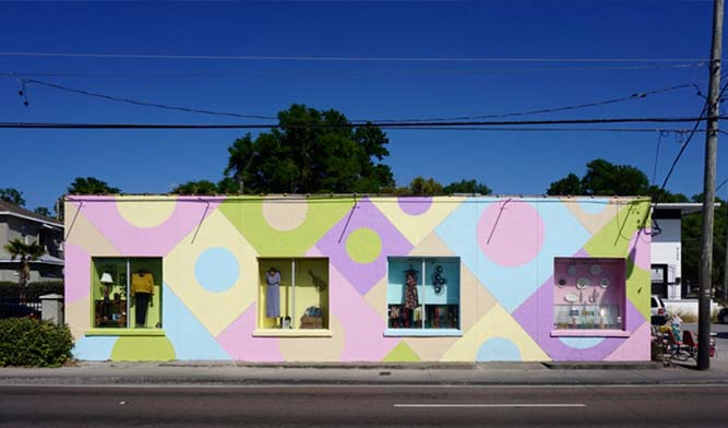 An exterior view of Yesterdaze Vintage Clothing & Antiques in Tampa, Florida show pastel-colored circles and squares on the storefront