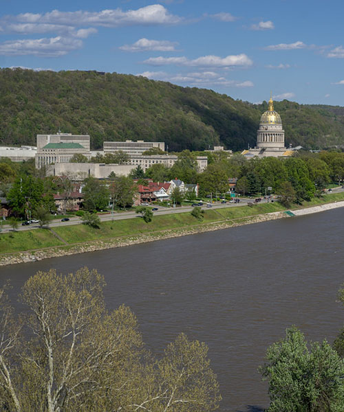 The beautiful riverbank of Charleston WV, with the capitol dome shining in the background.