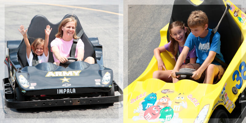 A child and her mother ride in an Army-themed go-kart and two children ride in an M&M's-themed go-kart at Gran Rally Go Karts in Osage Beach, Missouri