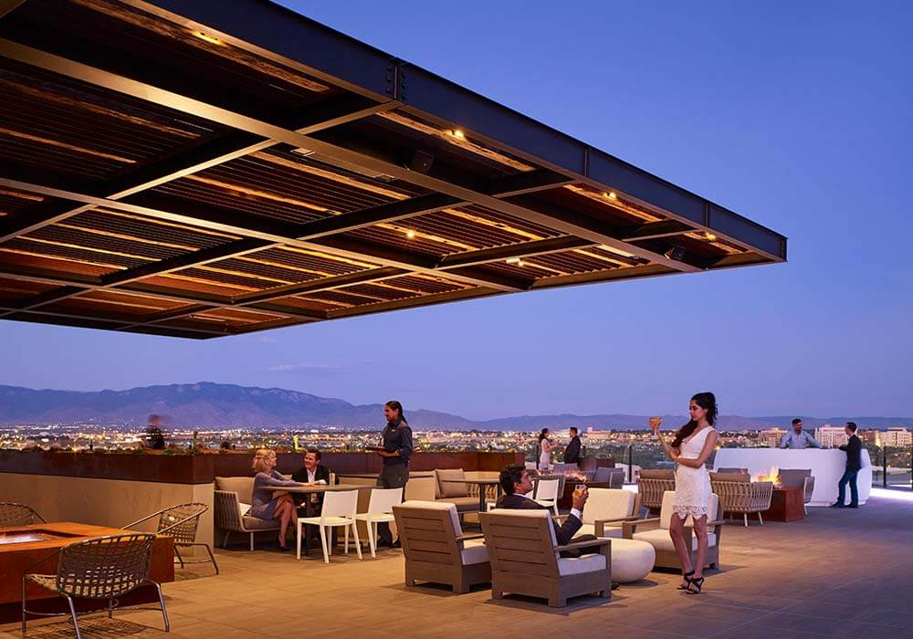 City lights and cocktails on the patio of Level 5 Restaurant at Hotel Chaco in Albuquerque