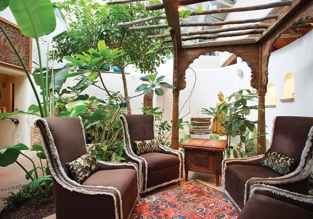A patio with artistic furnishings at El Monte Sagrado Resort.