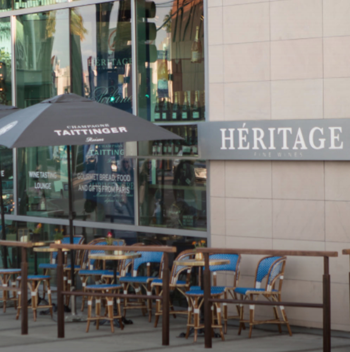 An outdoor seating area at Héritage Fine Wines in Beverly Hills, CA.