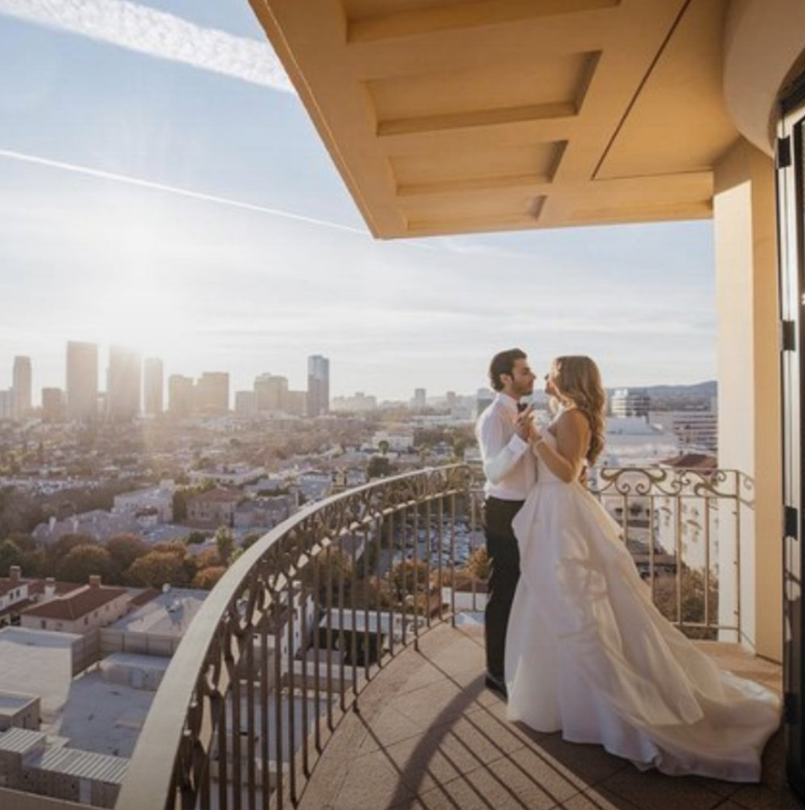 A couple dances on a balcony of the Four Seasons Beverly Wilshire Hotel in Beverly Hills, CA. Instagram photo by @dmitry_shumanev