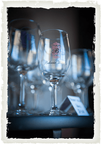 A wine glass engraved with the logo of Belvoir Winery in Liberty, MO
