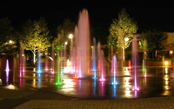 Lights illuminate the splash pad at Festival Park in Elgin, IL