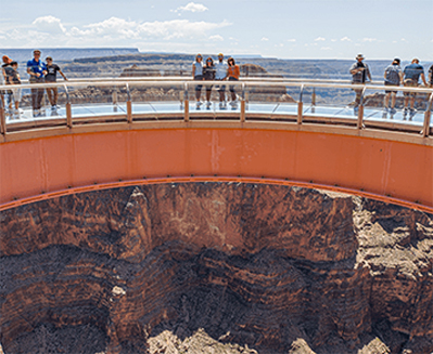 Visitors stand on the Skywalk at the Grand Canyon