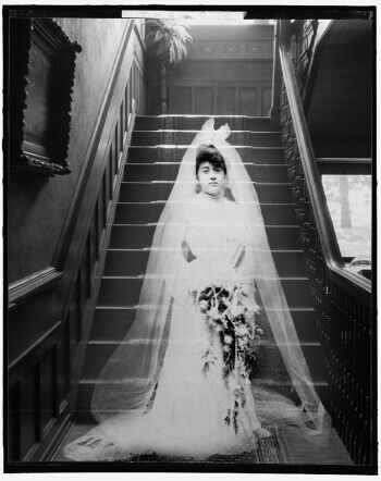 A ghost bride stands at the bottom of the staircase of the Bingham-Waggoner Estate in Independence, MO
