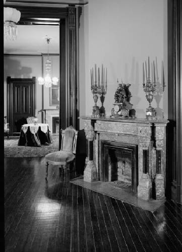 A black-and-white photo of a fireplace inside the Vaile Mansion in Independence, MO