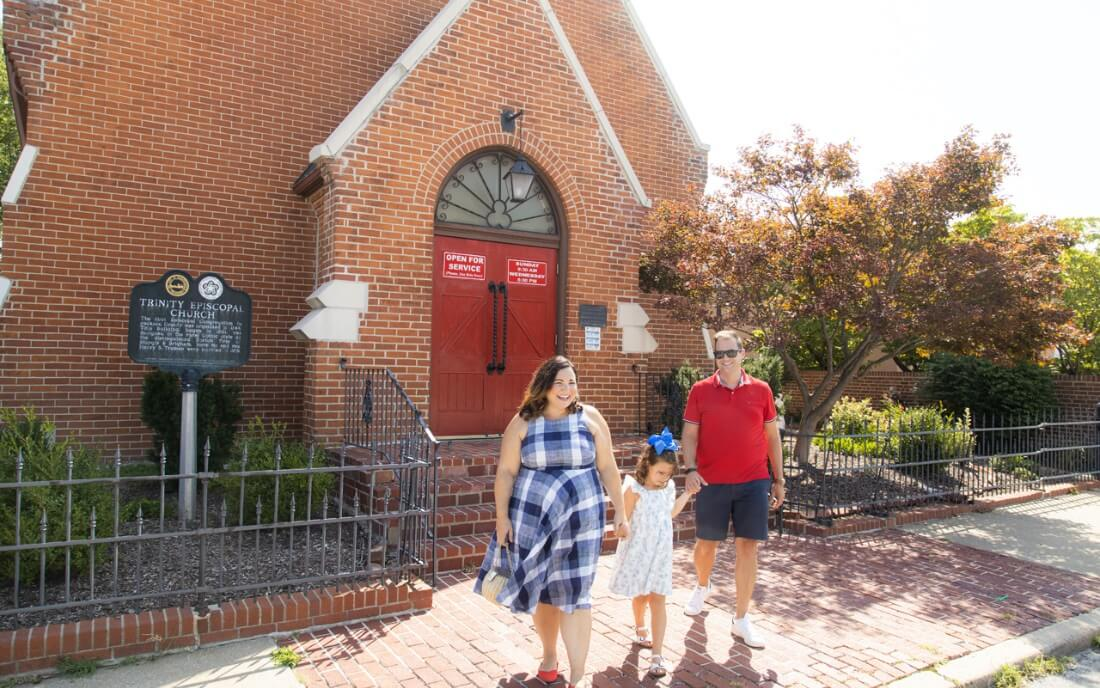Influencer Jen Cowan and her family in front of the Trinity Episcopal Church in Independence, MO