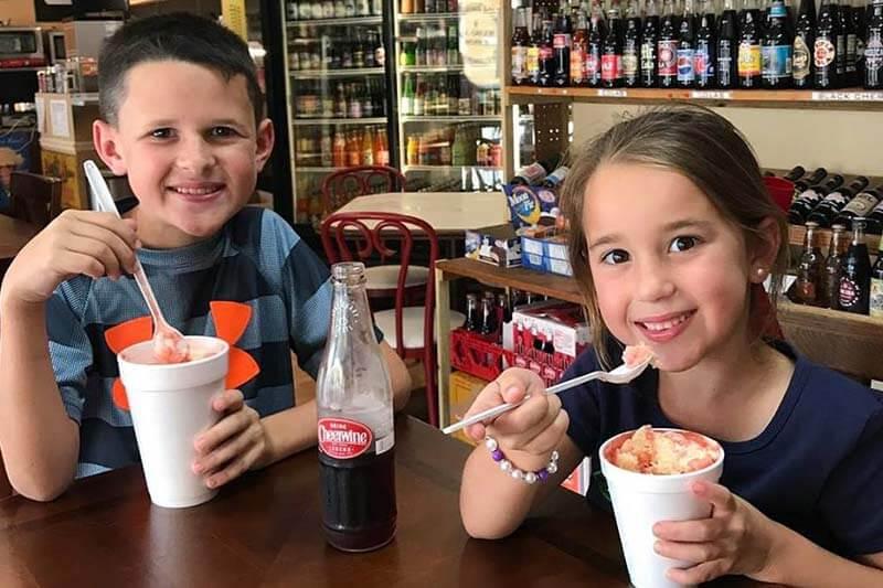 Two children enjoying ice cream sodas with Cheerwine at Sebring Soda and Ice Cream Works in Sebring, Florida.