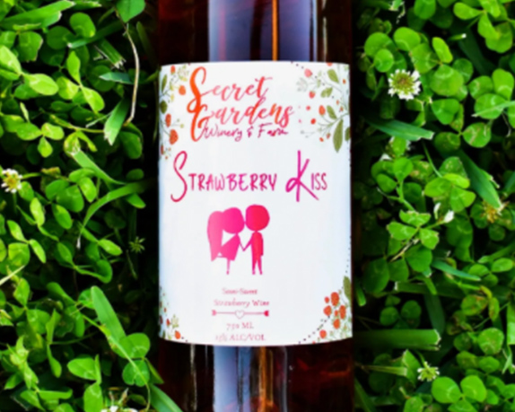 A bottle of Strawberry Kiss Wine from Secret Gardens Winery & Farm in Sebring, Florida.
