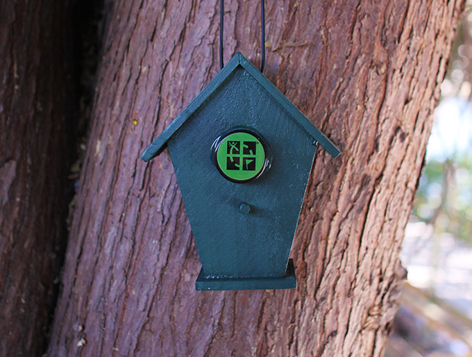 A miniature birdhouse makes a great geocache container.