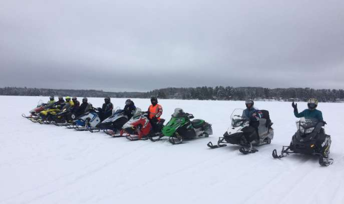 Snowmobiles lined up, ready to ride in St Germain.
