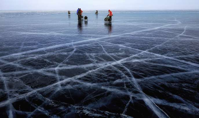 Fishermen drilling through the ice in St. Germain