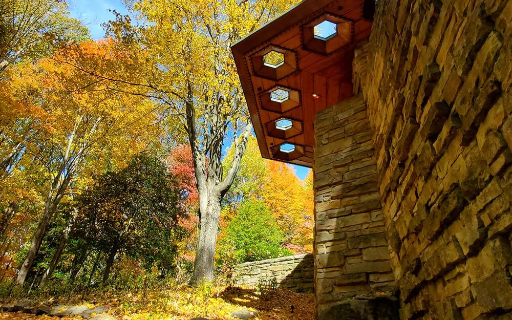 Frank Lloyd Wright's Usonian Style, exemplified at Kentuck Knob, features native materials, flat roofs and large cantilevered overhangs.