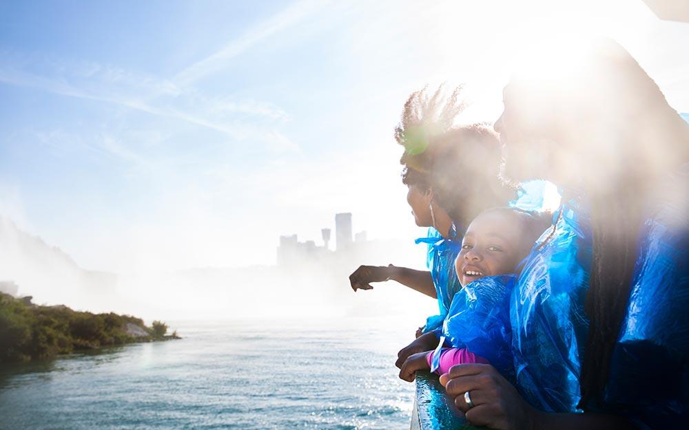 Family on the shore of Niagara Falls in Buffalo NY.