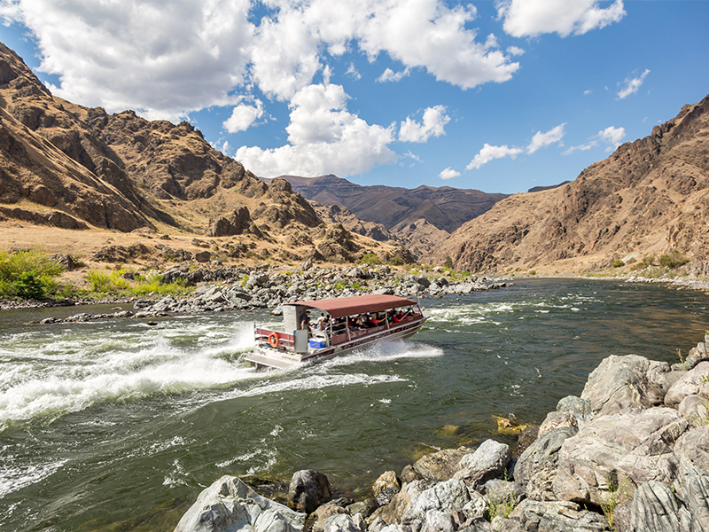 A Hells Canyon jet boat splashes in whitewater rapids in the Snake River in Idaho.