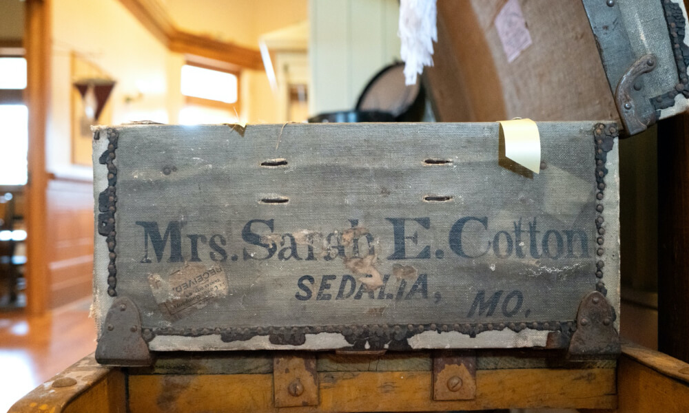 A historic wooden trunk labeled rs. Sarah E. Cotton