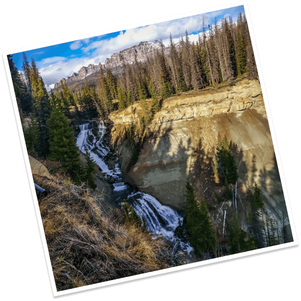 White water tumbles over granite cliffs at the Brooks Lake Creek Falls in Dubois, Wyoming.